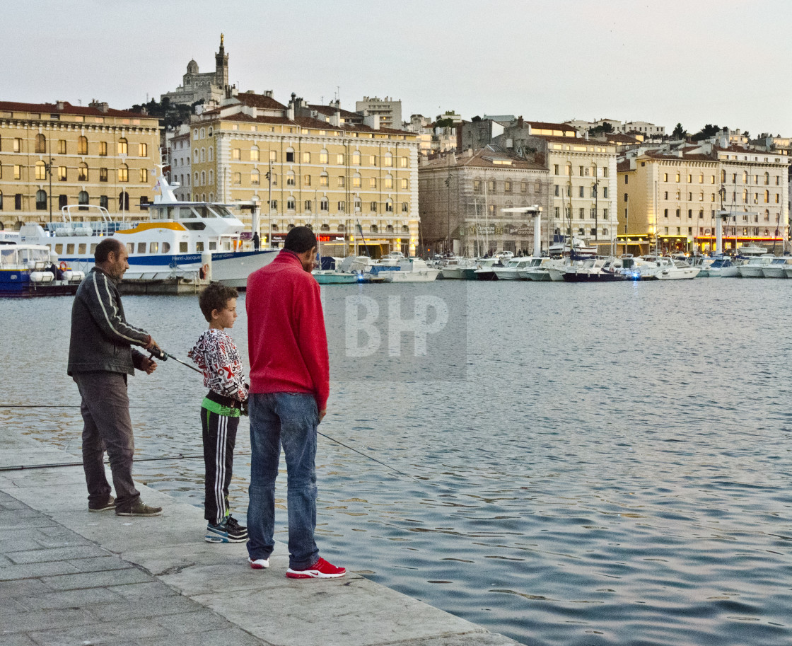 """Fishing at Marseille's Vieux Port"" stock image"