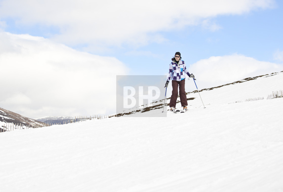 """Young woman enjoying ski holiday"" stock image"