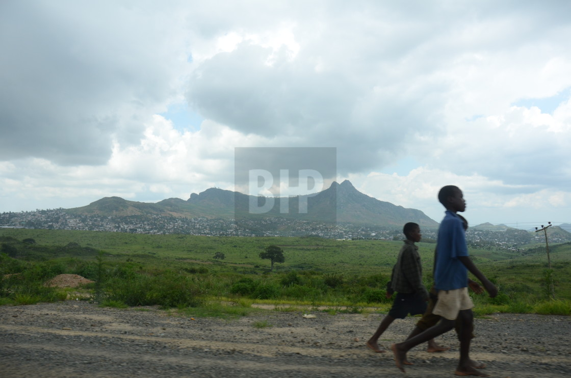 """Children walking along a road in Malawi"" stock image"