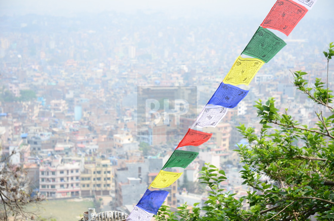 """Prayer Flags and Pollution Haze, Kathmandu"" stock image"