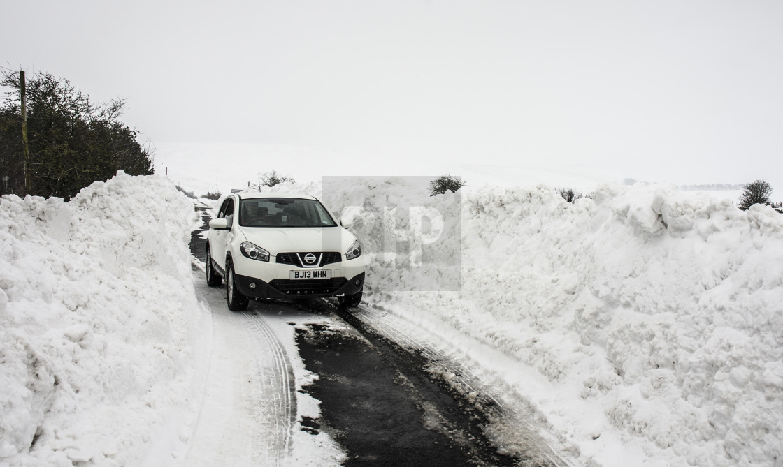 """Road Cleared through Deep Snow"" stock image"