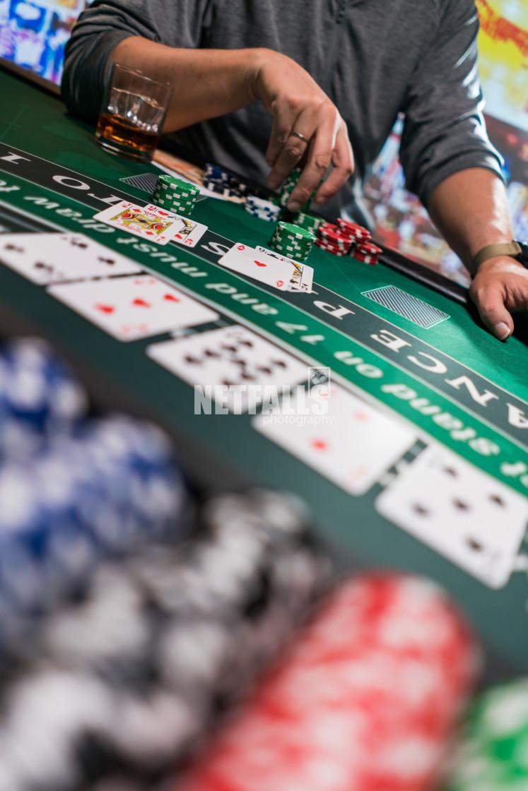 """Man playing BlackJack at the casino"" stock image"