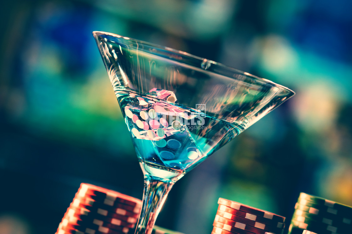 """cocktail glass on the casino gambling table"" stock image"