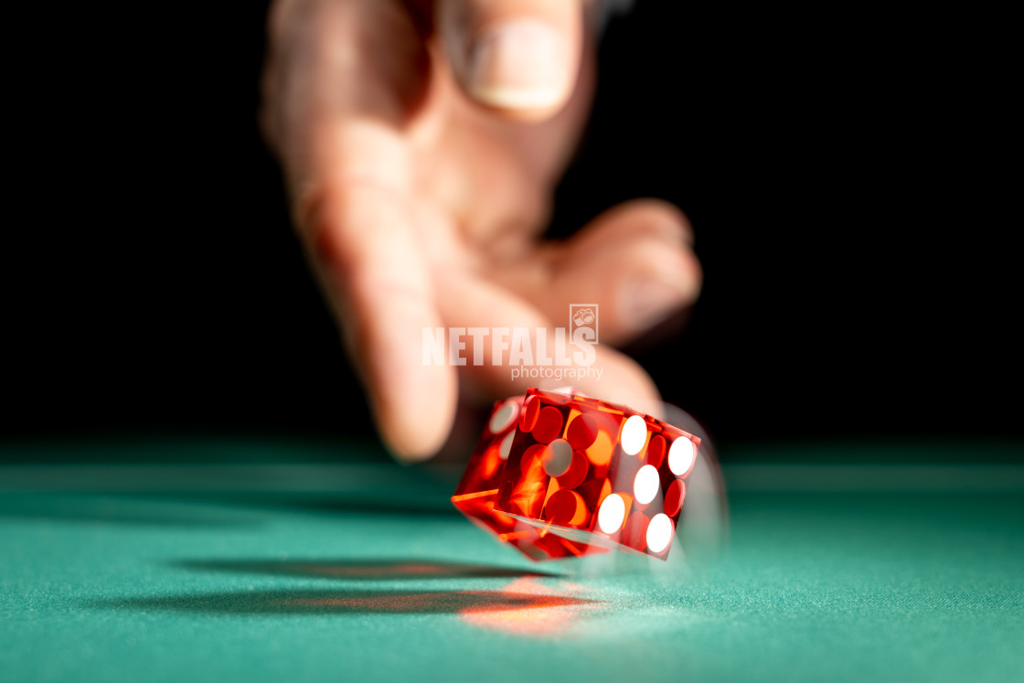 """Man gambling at the craps table"" stock image"
