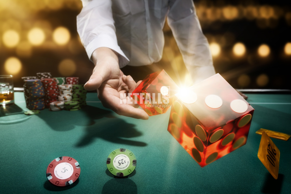 """Man gambling at the craps table"" stock image"