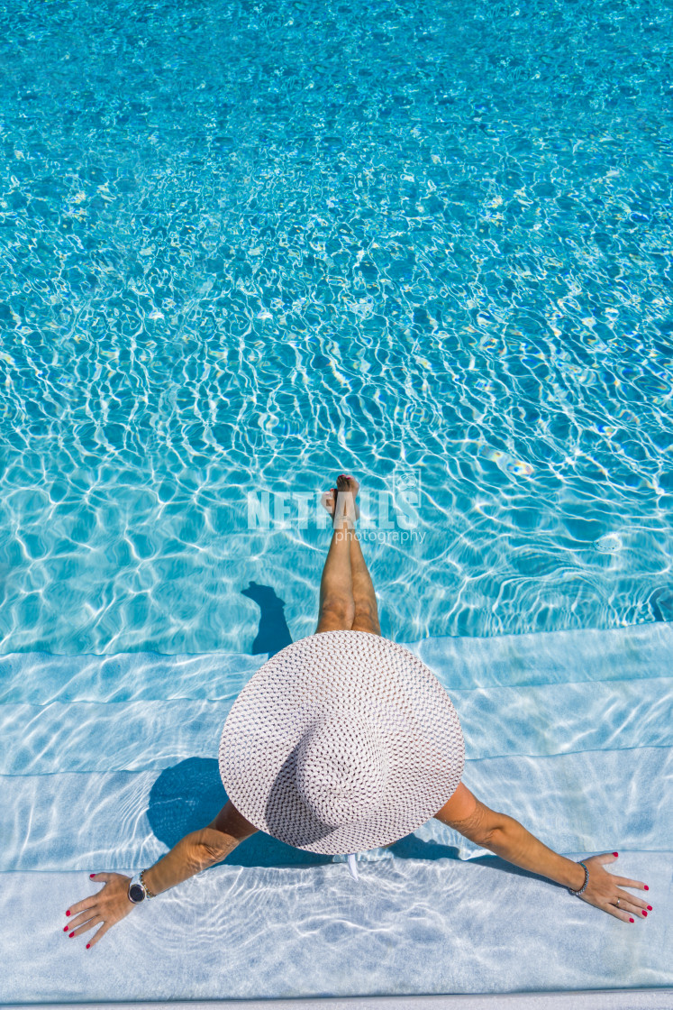 """woman in luxury spa resort near the swimming pool."" stock image"