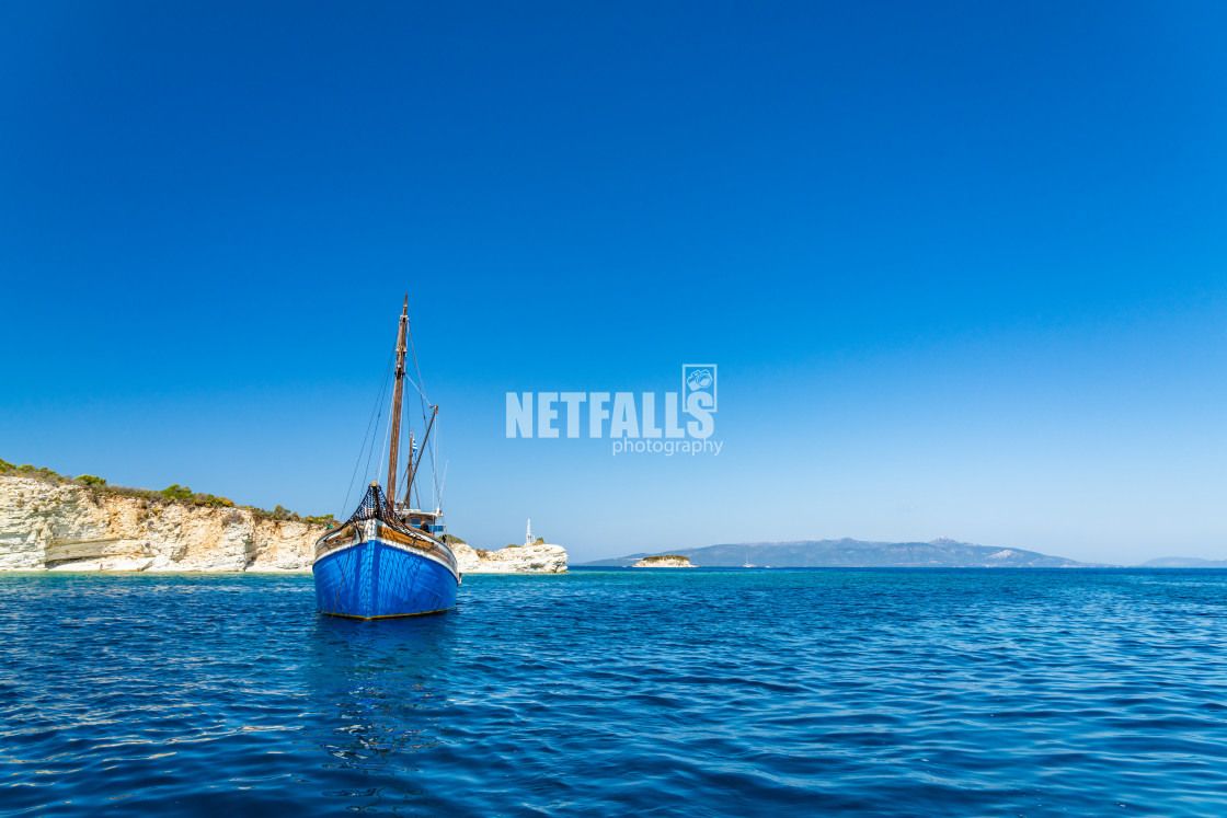 """Sailing boat at sea in Meganisi"" stock image"