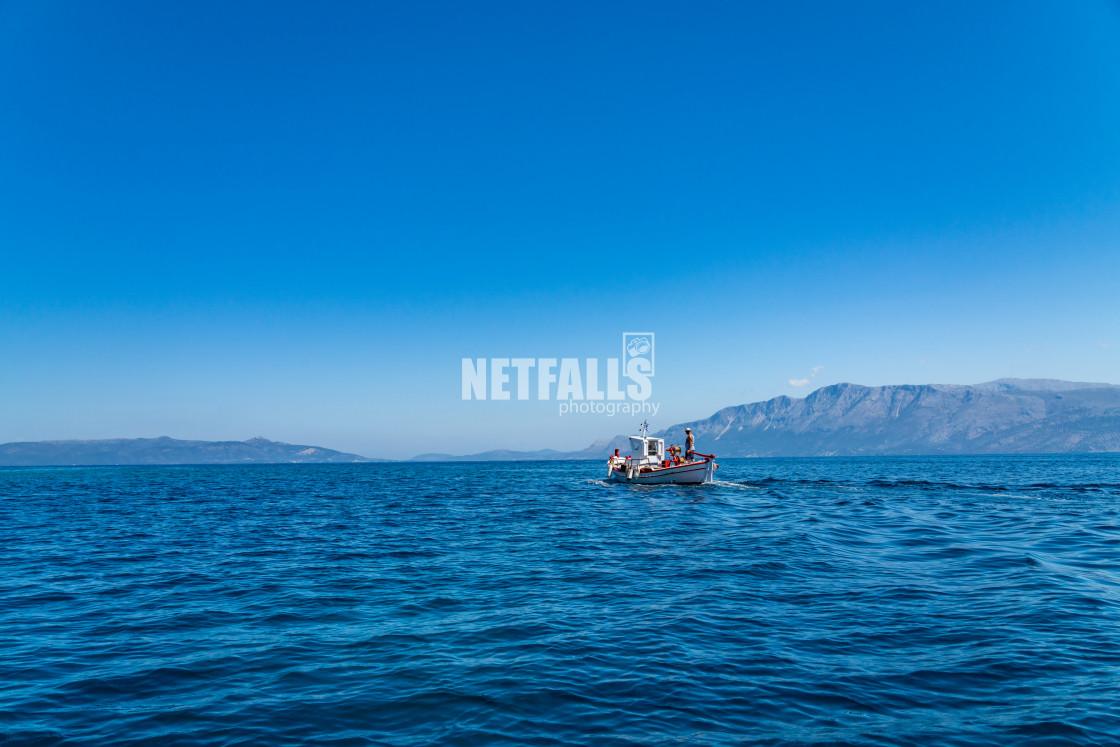 """boat at sea in Meganisi island"" stock image"