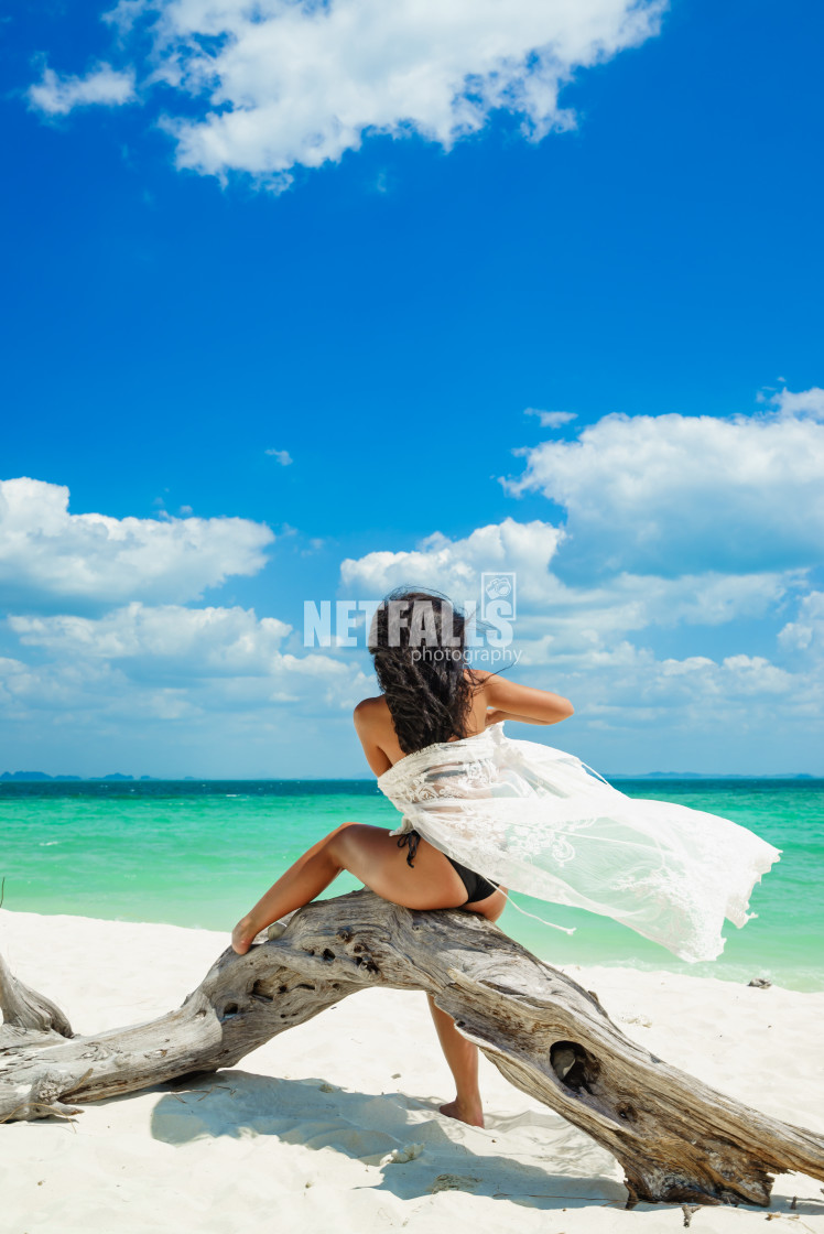 """Young woman on the white sand beach"" stock image"