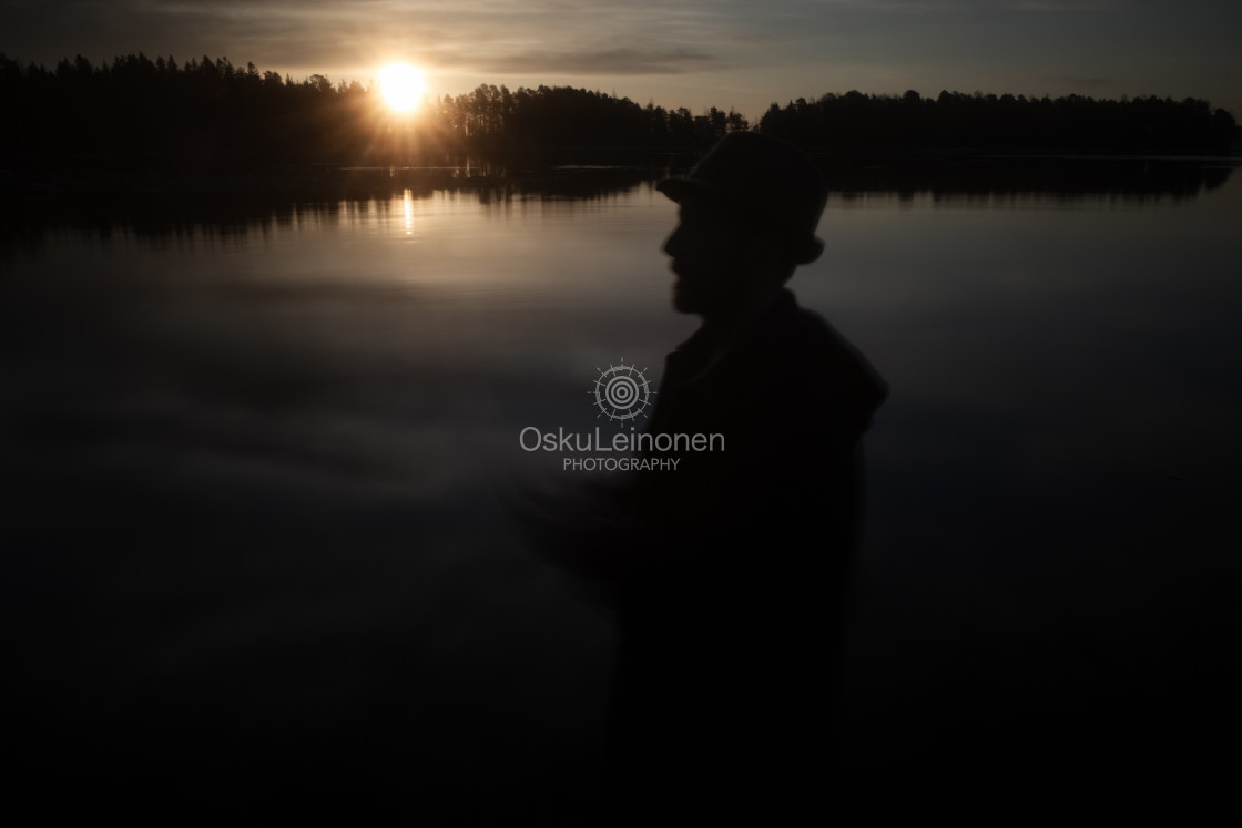 """""""A Man With A Hat I (At The Lake In Morning)"""" stock image"""
