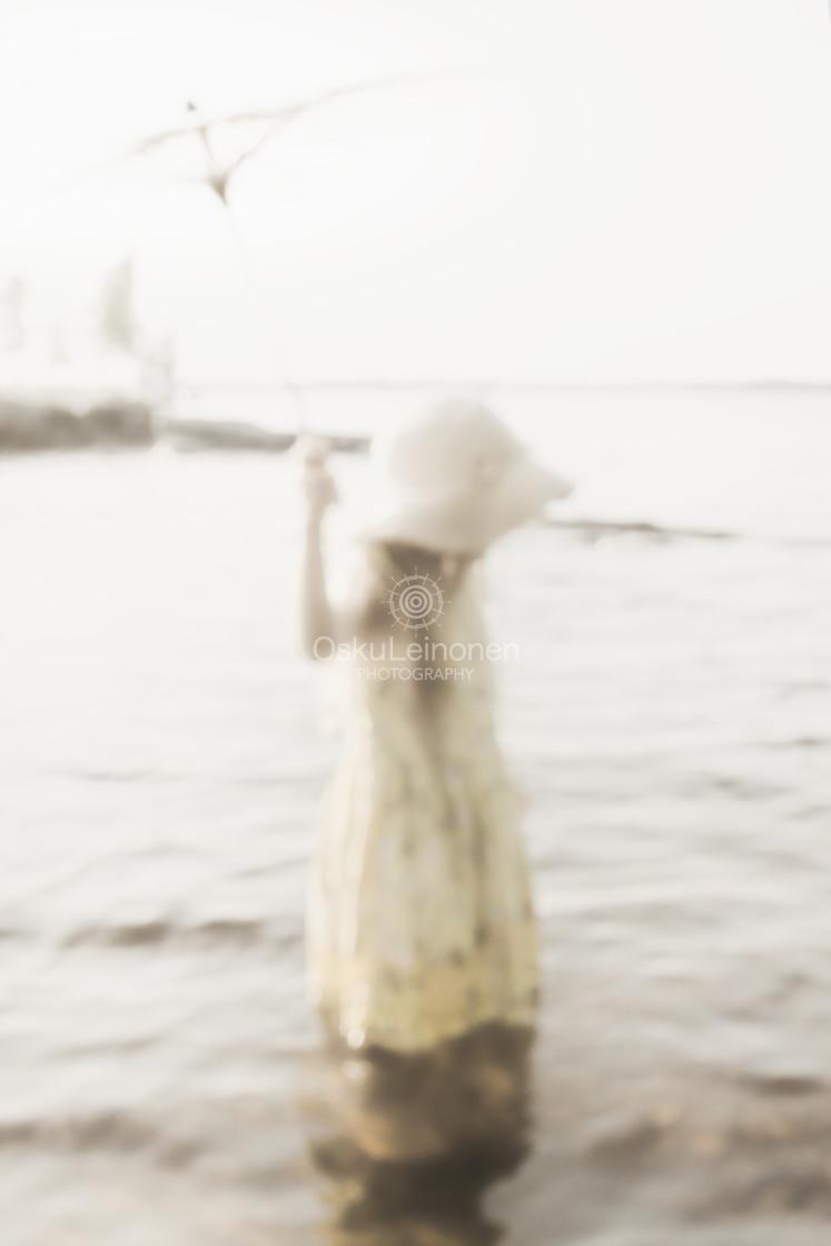 """Sunshade And GirlI I (Warm Water)"" stock image"