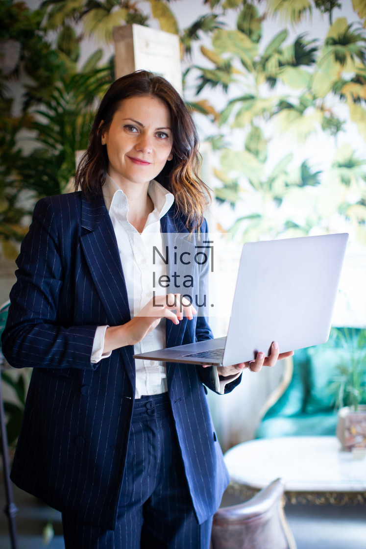 """business woman working in a coffee shop"" stock image"