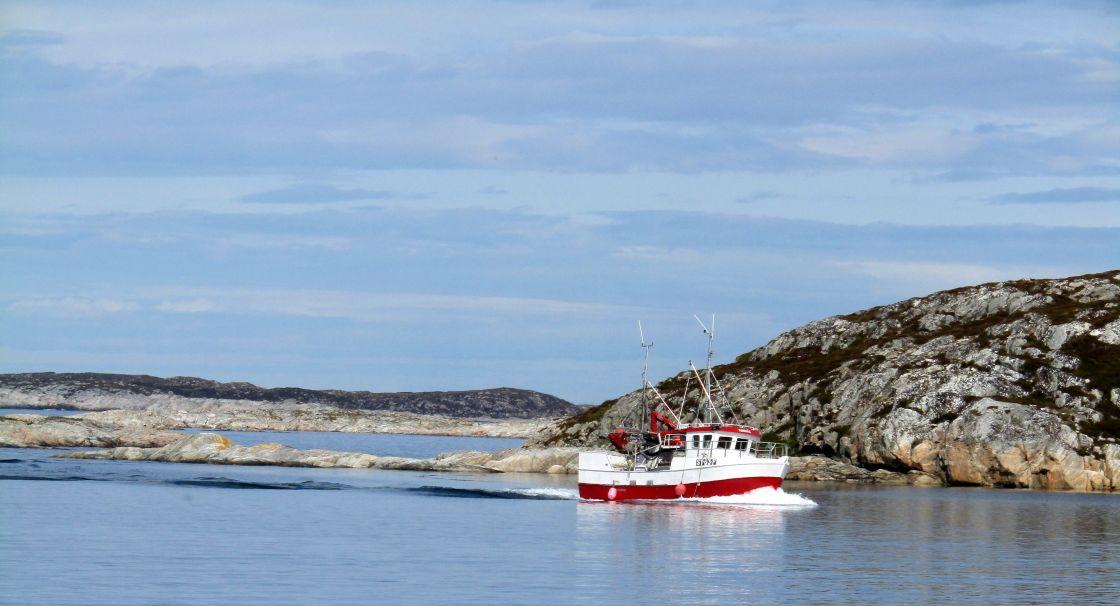 """Fishing boat entering Froya, Norway"" stock image"