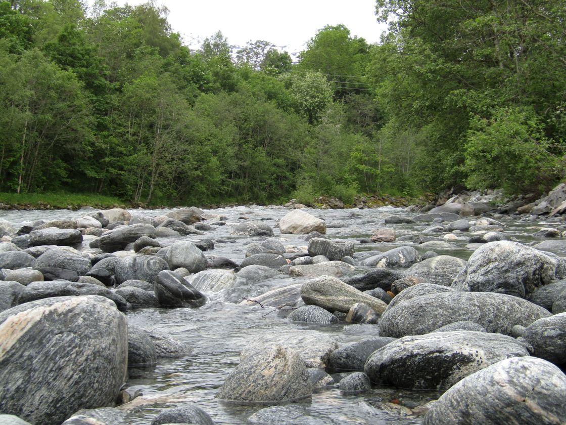 """Stranda, Norway river with boulders"" stock image"
