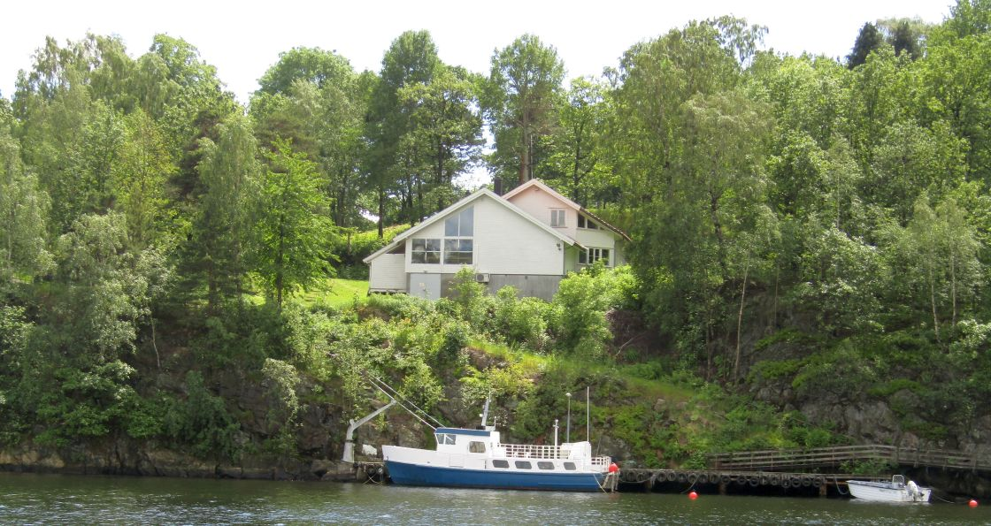 """""""Kristiansand, Norway house and boat"""" stock image"""