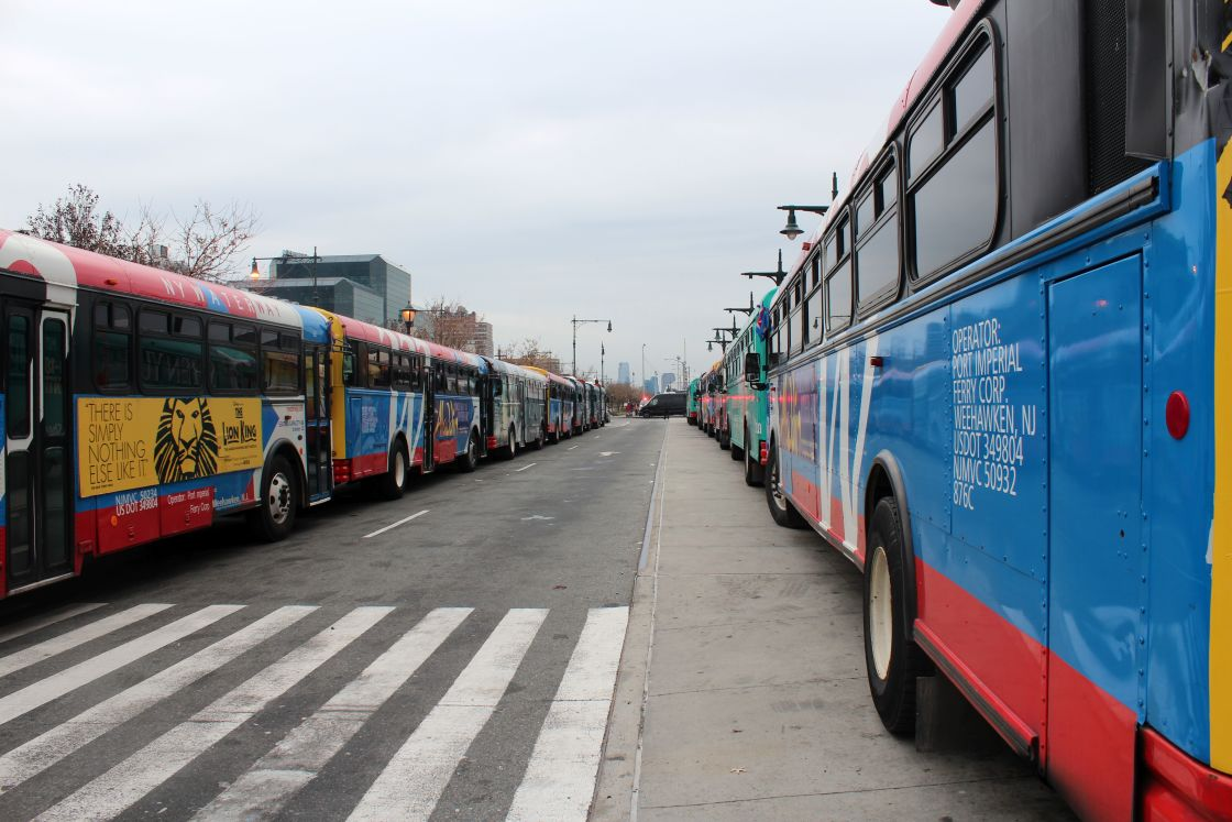 """New York buses queued in street"" stock image"