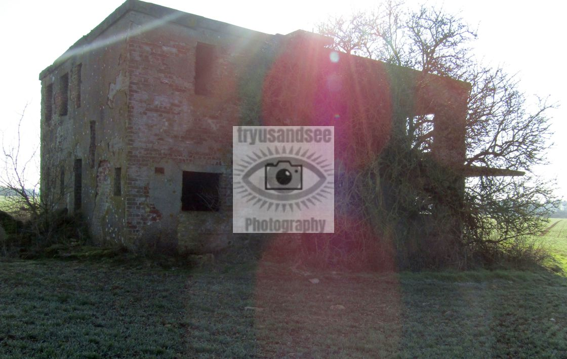 """Derelict building with 'eyes' in Oxfordshire in sunlight"" stock image"