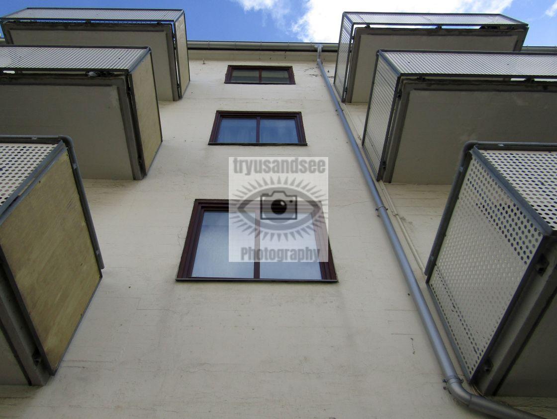 """Looking up to balconies in Trondheim"" stock image"
