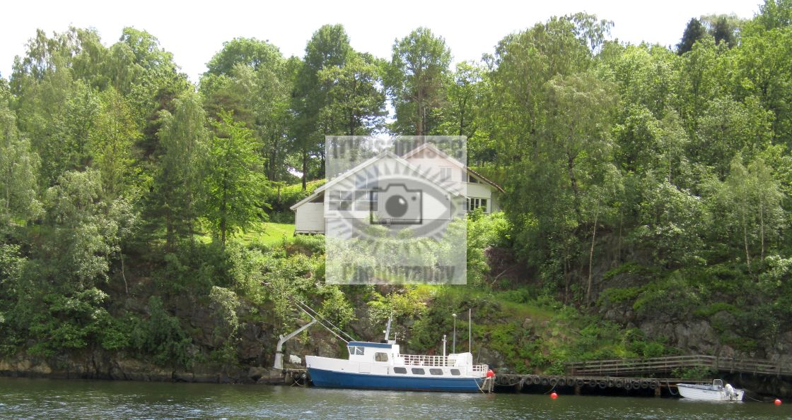 """Kristiansand, Norway house and boat"" stock image"
