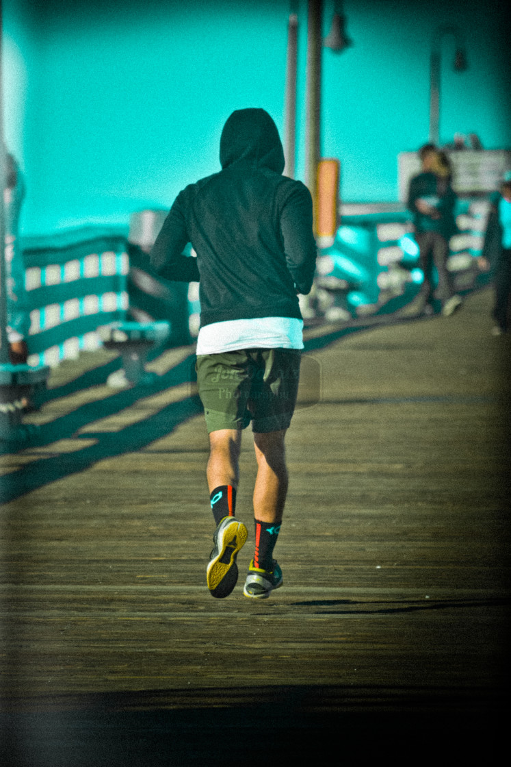 """Jogger on a Pier"" stock image"