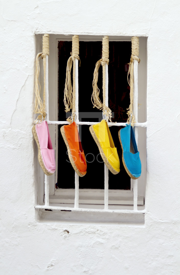 """Four brightly colored shoes"" stock image"