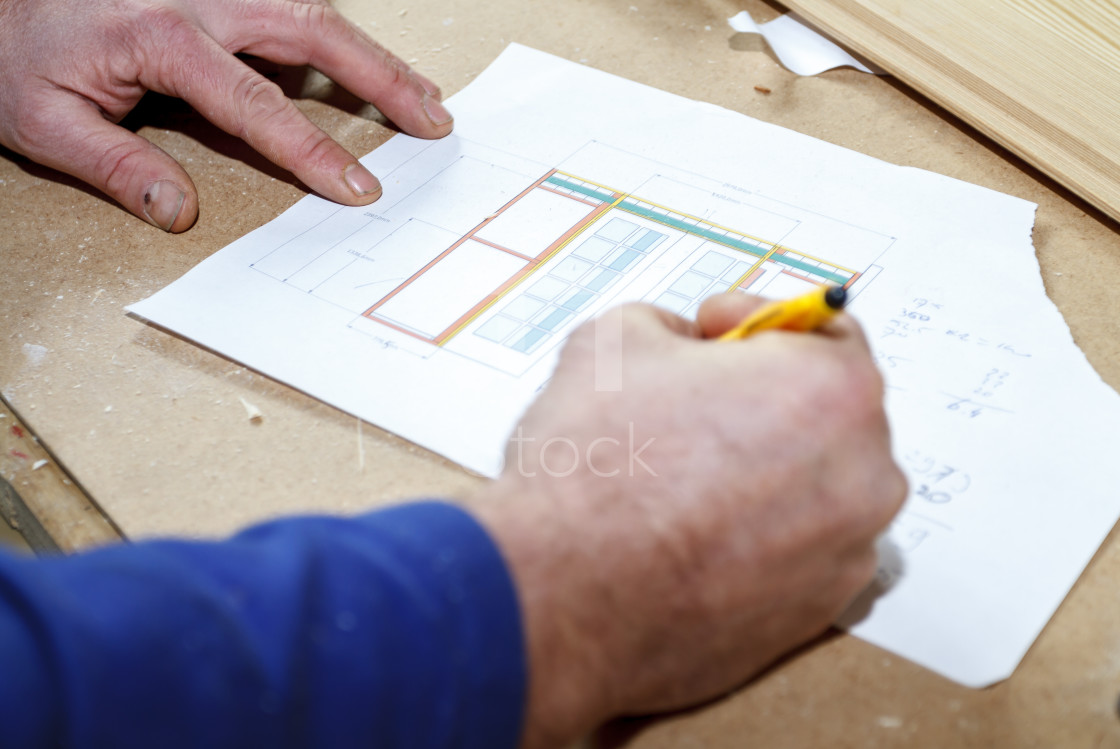 """Carpenter making drawings"" stock image"
