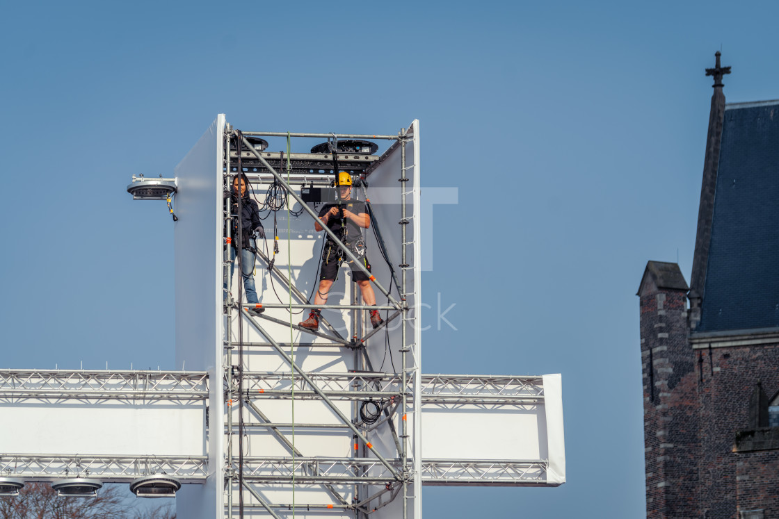 """Working on the scaffolding used for The Passion"" stock image"