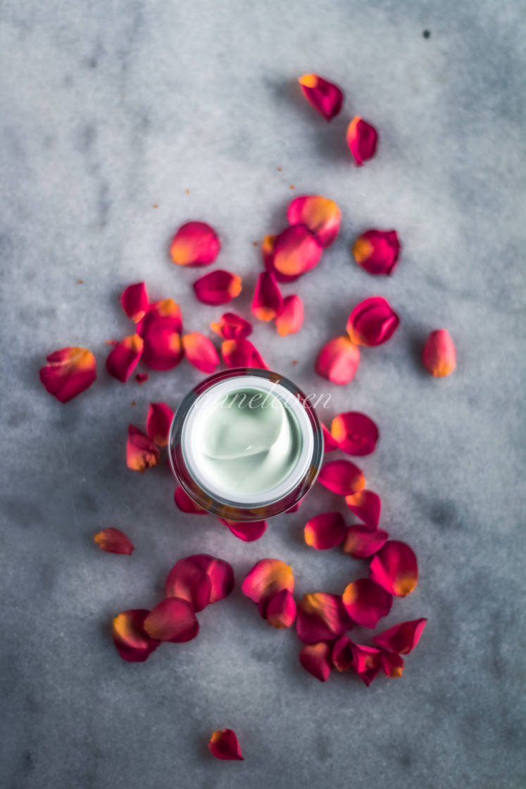 """luxe face cream and rose petals - cosmetics with flowers styled"" stock image"