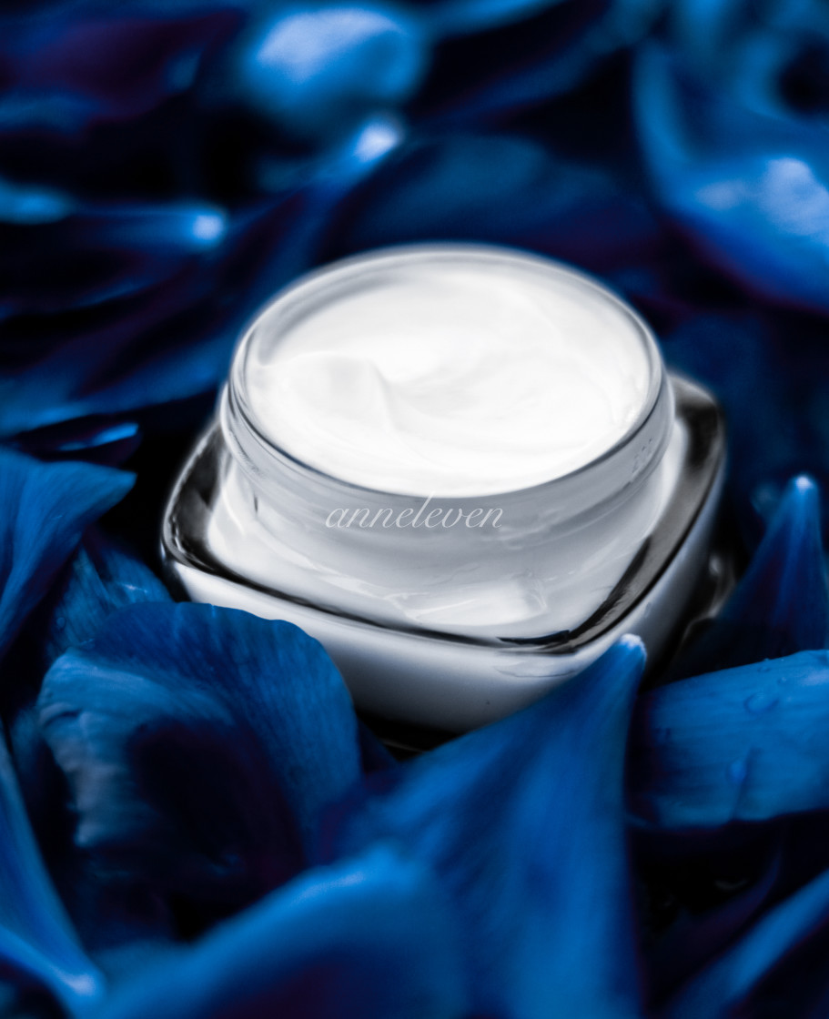 """Luxury face cream moisturizer for facial skin on blue flower background,..."" stock image"