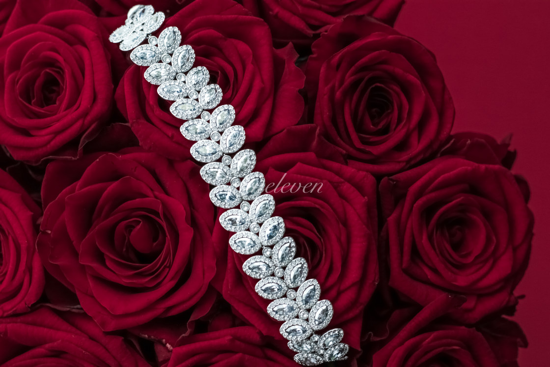 """Luxury diamond jewelry bracelet and red roses flowers, love gift on..."" stock image"