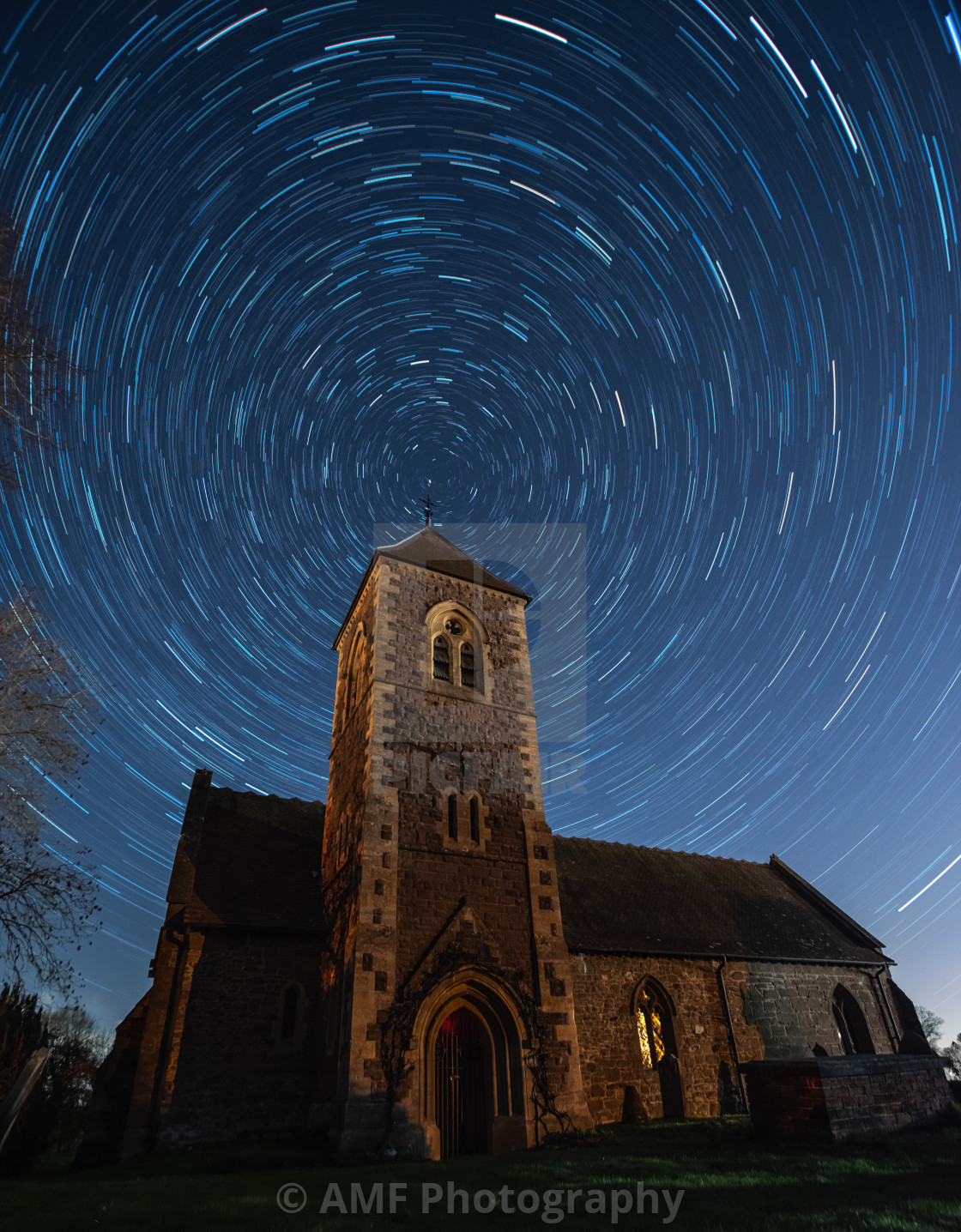 """Star trails Church Night Sky"" stock image"