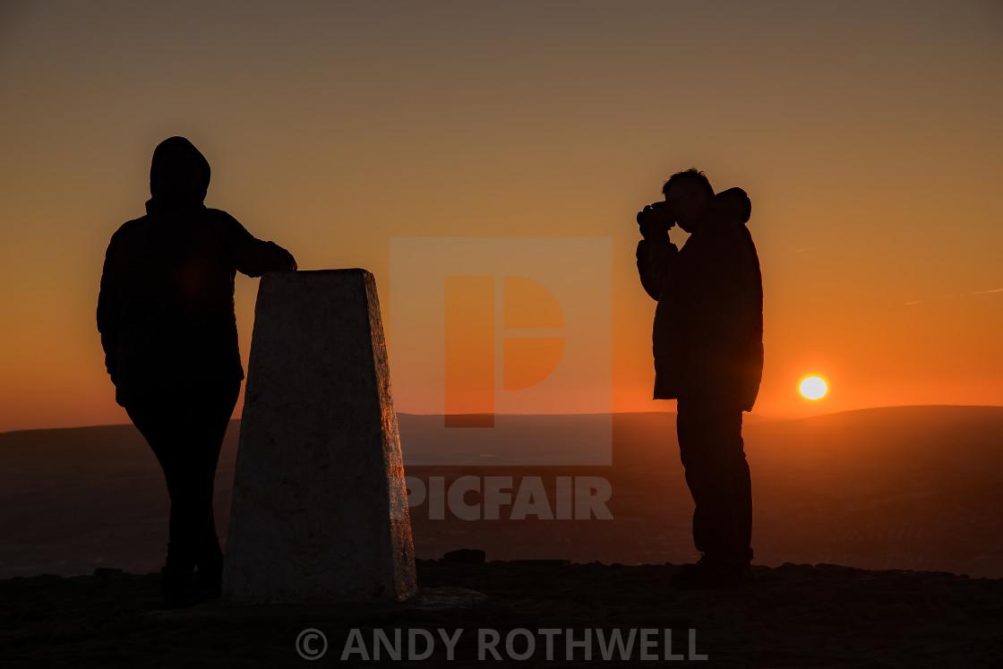 """Sunrise silhouettes.."" stock image"