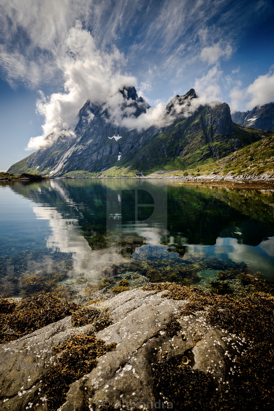 """""""Fuming clouds over mountain in Lofoten"""" stock image"""