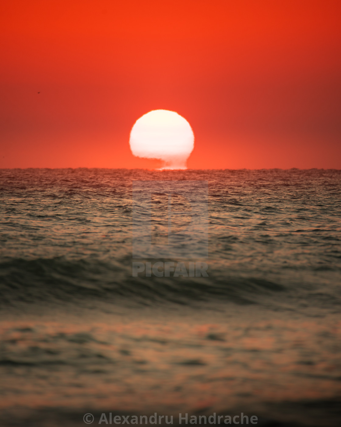 """Sun rising above the sea"" stock image"