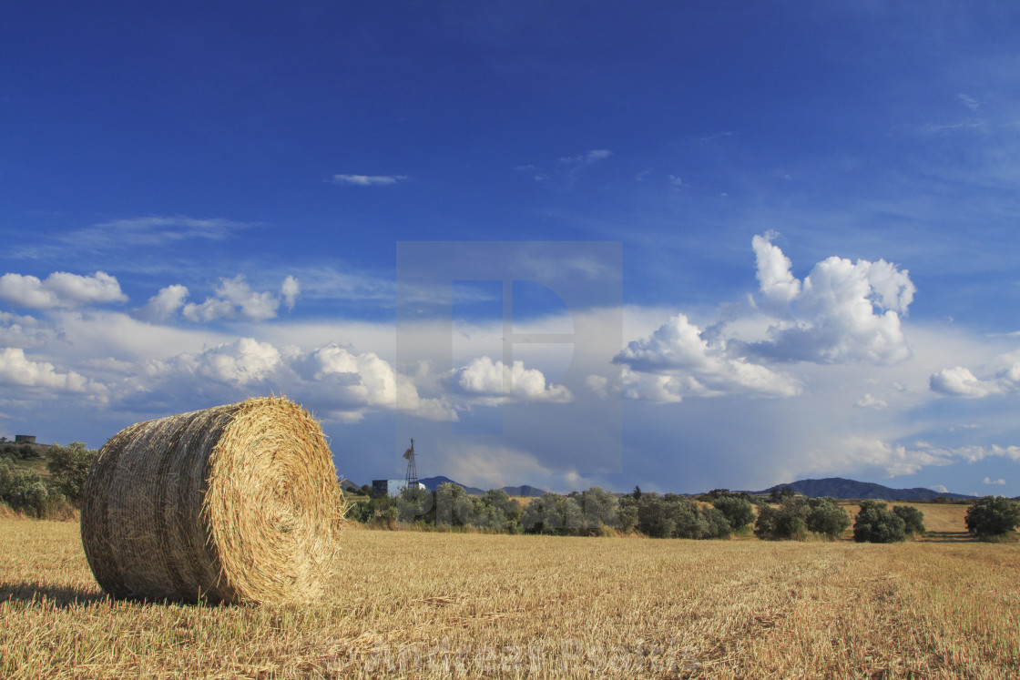 """""""Hay Bales With Blue Sky And Fluffy Cloud"""" stock image"""
