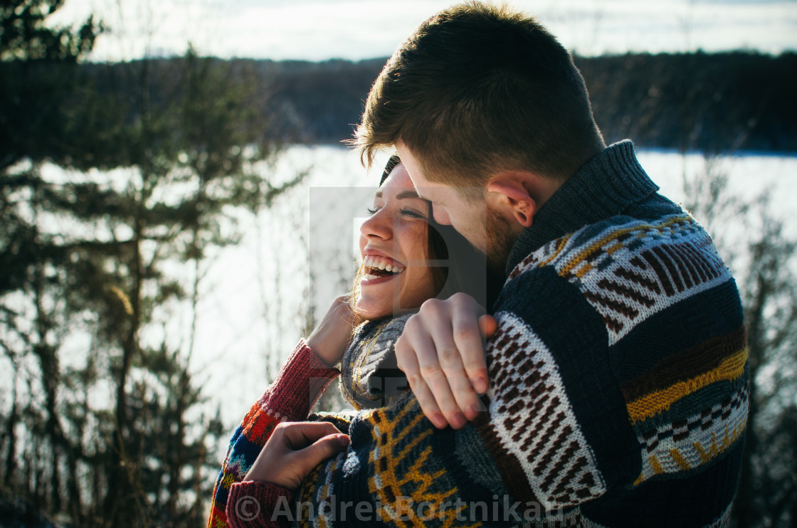 """""""Happiness couple embraces. Young man hugs a girl."""" stock image"""