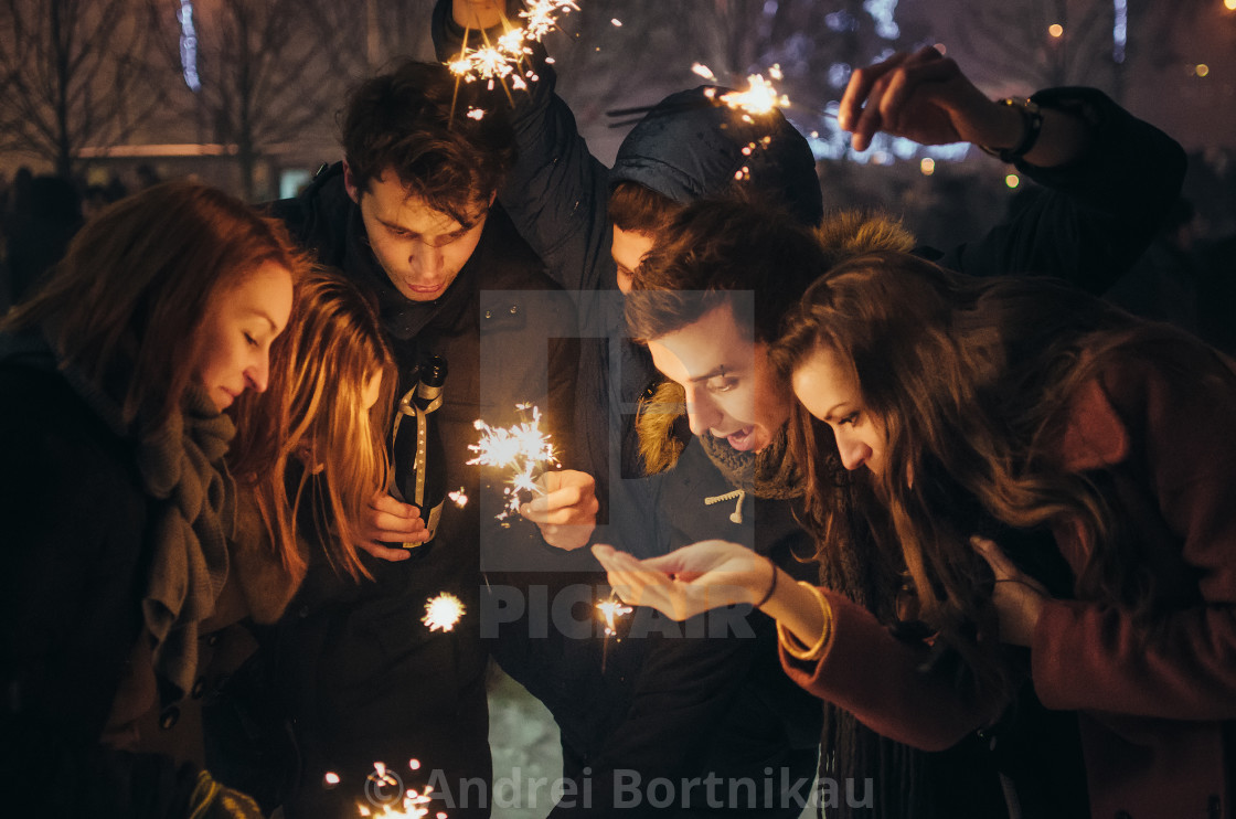 """People with sparklers Christmas party outdoor"" stock image"