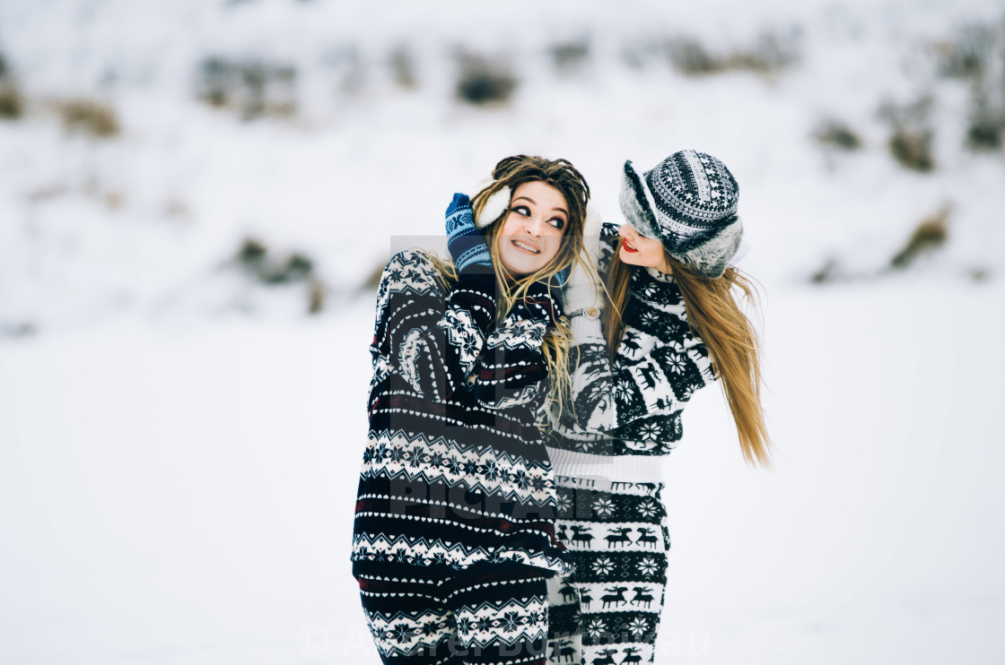 """""""Couple of young woman are wearing warm clothes in winter"""" stock image"""