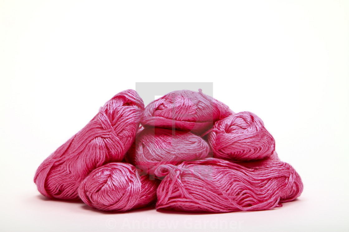 """Balls of pink knitting wool isolated on a white background"" stock image"