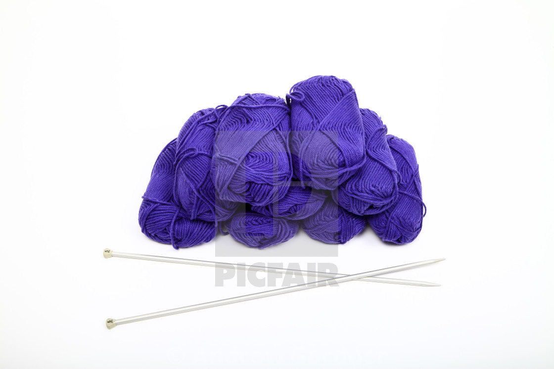 """""""Balls of blue knitting wool and needles isolated on a white background"""" stock image"""