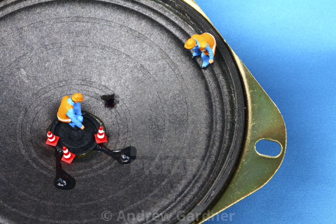"""Miniature figure workmen inspecting damage to a loudspeaker HI FI repair concept"" stock image"