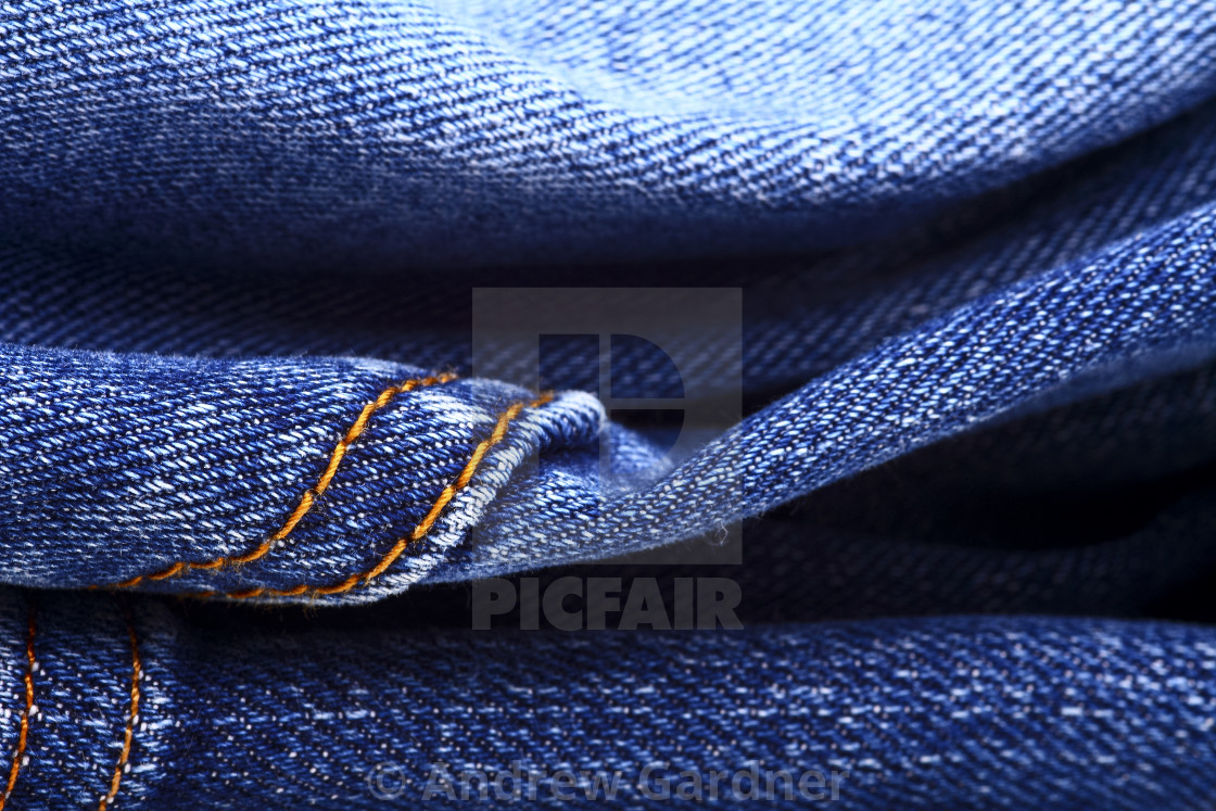 """Background of blue indigo denim jeans"" stock image"