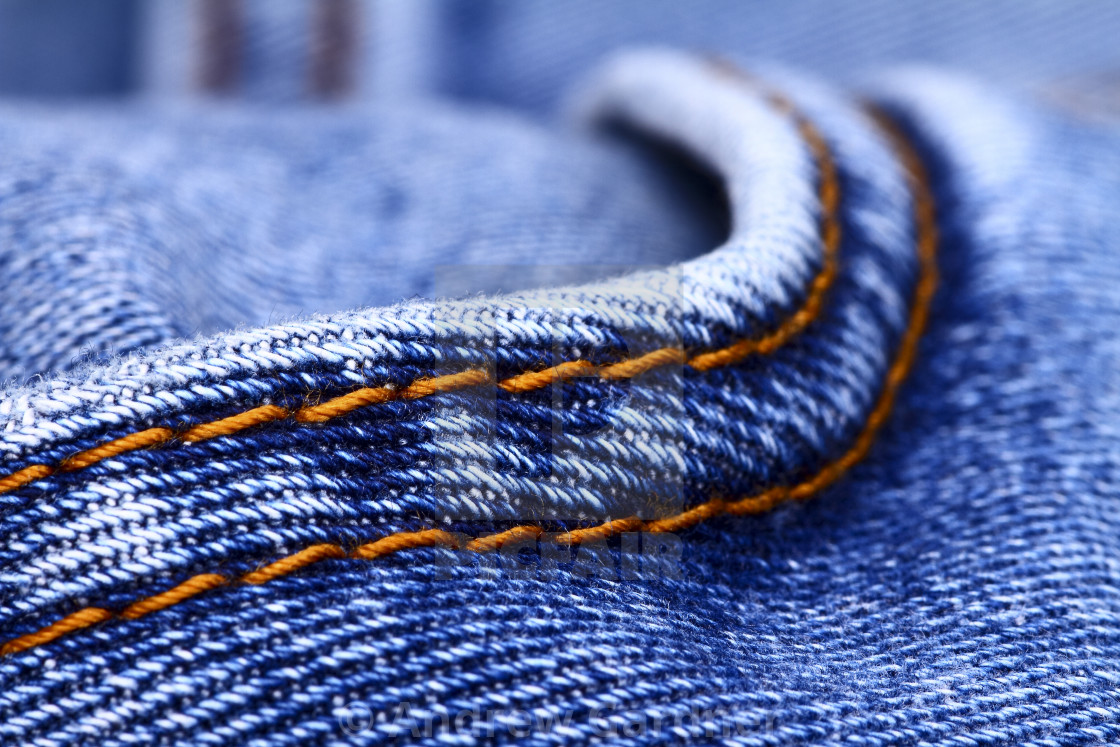 """Background of blue indigo denim jeans and stiching"" stock image"