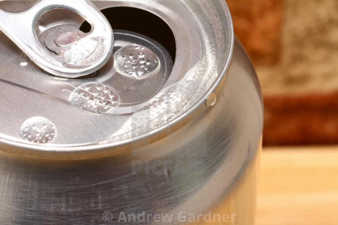 """Close up view of an open aluminum fizzy drinks can"" stock image"