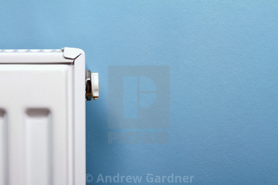 """Close up of a central heating radiator and bleed valve"" stock image"