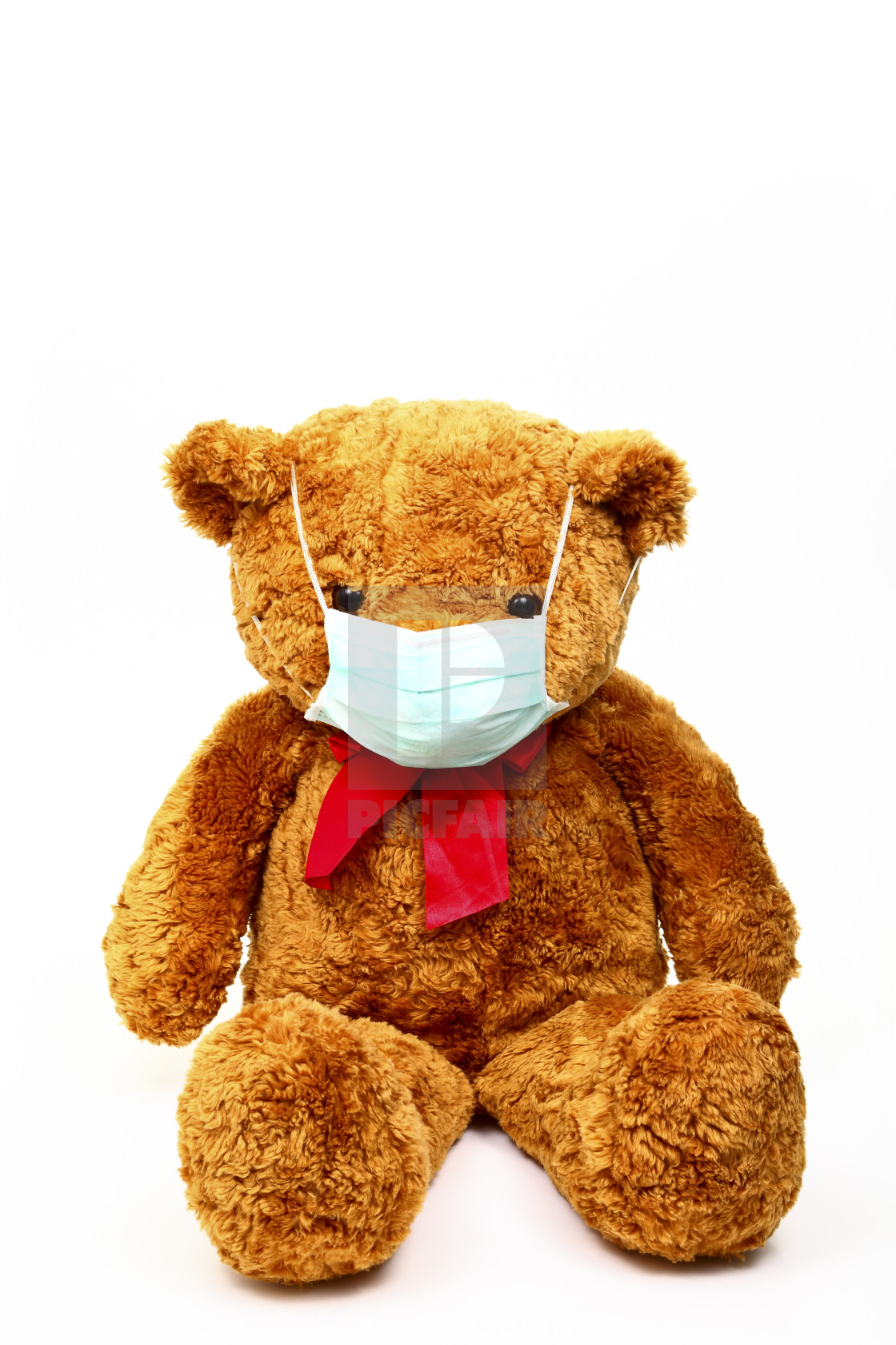 """""""Conceptual image of a teddy bear wearing a face mask to help stop the spread of covid 19"""" stock image"""