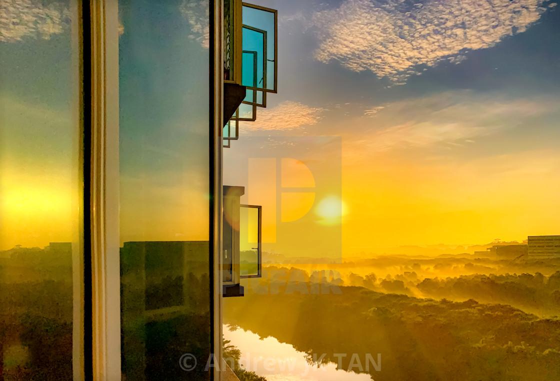 """""""Windows and Sunrise Reflections"""" stock image"""