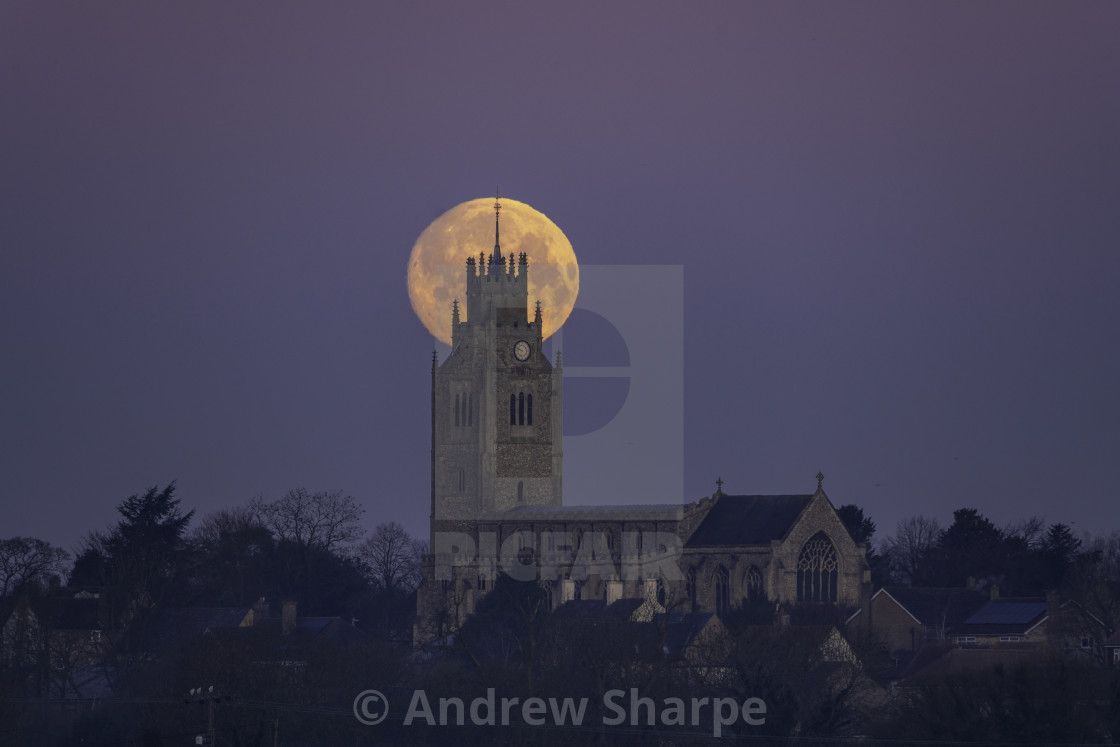 """""""Snow Moon (or Hunger Moon) setting behind St Andrew's Church"""" stock image"""