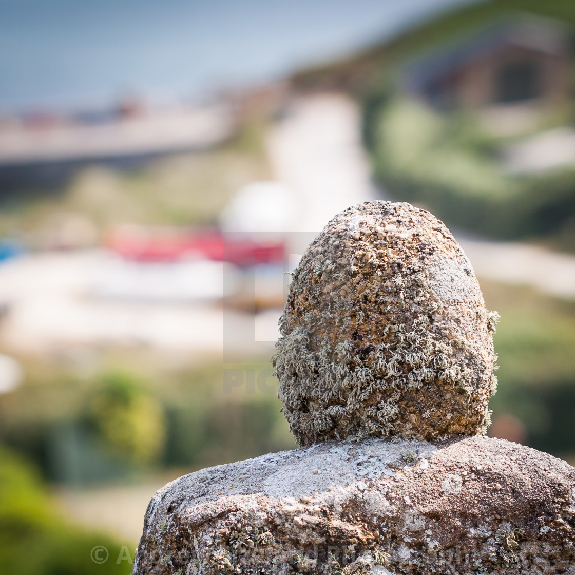 """""""Petrified Old Man Looking out to Sea - or a Gatepost?"""" stock image"""