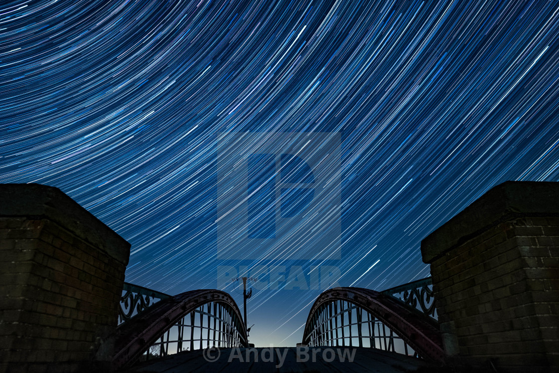 """Bridge Under The Star Trails"" stock image"